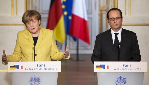Alemania y Francia quieren que Grecia siga en el euro