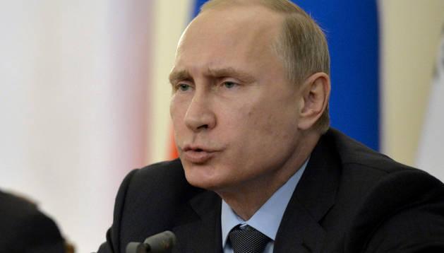 Vladimir Putin con su homólogo chipriota, Nicos Anastasiades.