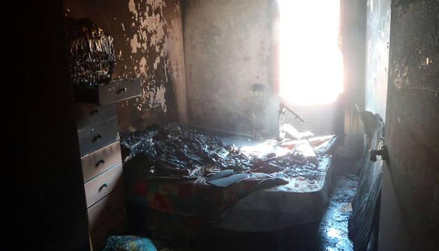 Estado en el quedó parte de la vivienda tras el incendio.