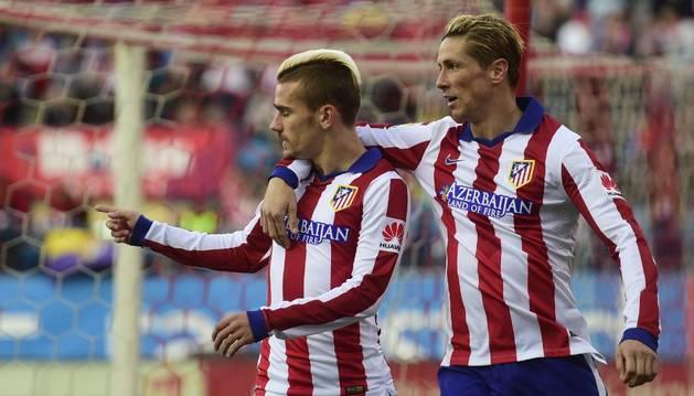 Griezmann celebra su gol con Torres
