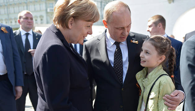 Vladimir Putin y Angela Merkel liman sus diferencias