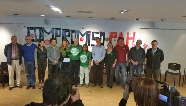 Representantes de los partidos firmantes.
