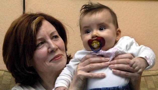 Raunigk, con su hija Lelia, que ahora tiene 9 años.