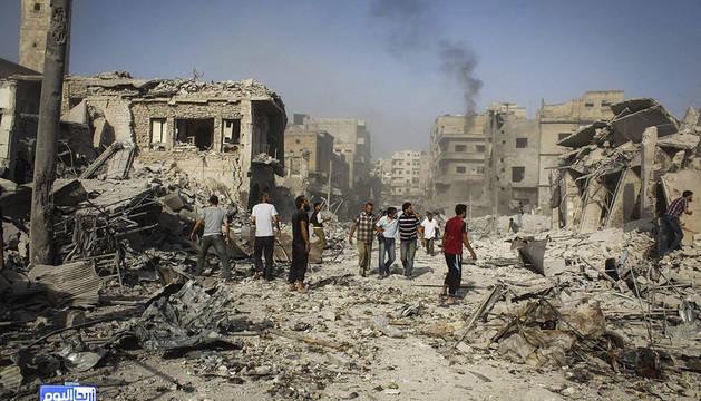 Varios edificios supuestamente destruídos tras un bombardeo en Ariha.