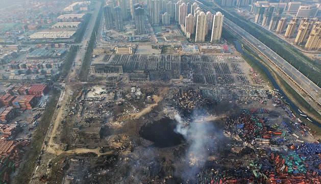 Vista aérea de la zona afectada por las explosiones producidas el miércoles en un almacén del puerto de Tianjin.