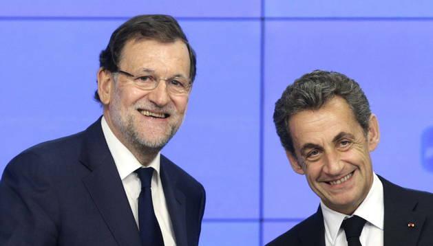 Mariano Rajoy y el expresidente francés Nicolás Sarkozy.
