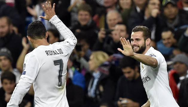 Nacho celebra un gol con Cristiano.