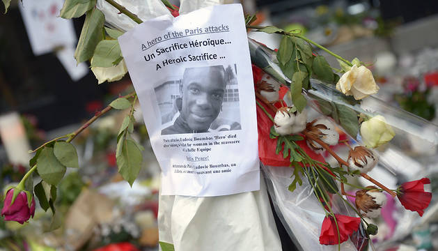 Flowers have been laid next to a placard bearing the picture of Ludovic Boumbas, one of the victims, at a memorial at the site of the attack at the Cafe Belle Equipe on rue de Charonne