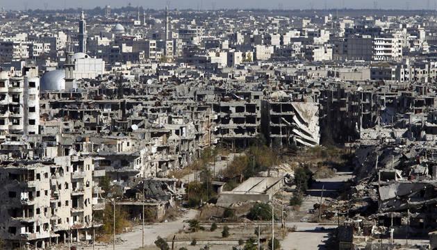 Los rebeldes comienzan a evacuar el último barrio en sus manos de Homs
