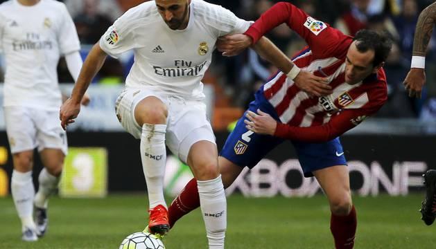 Karim Benzemá y Diego Godín.