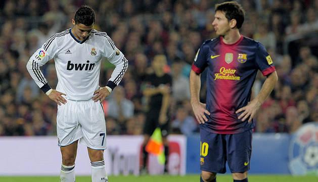 Cristiano Ronaldo y Lionel Messi, en un encuentro entre Real Madrid y FC Barcelona.