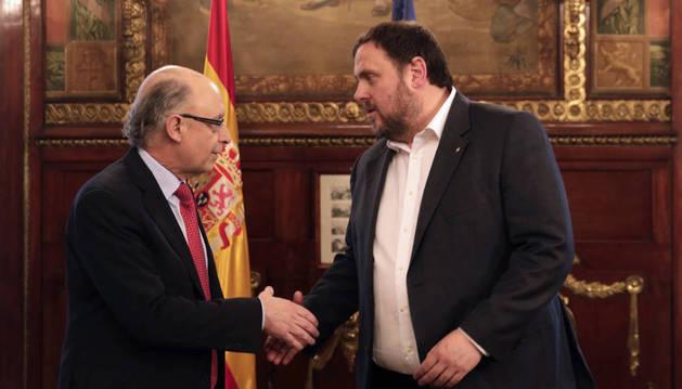 Montoro y Junqueras se comprometen a evitar la quiebra de la Generalitat