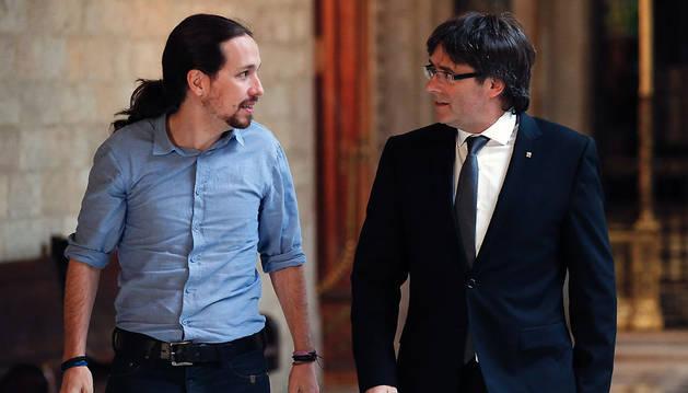 Carles Puigdemont y Pablo Iglesias, en la Generalitat.