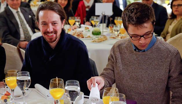Iglesias y Errejón, en un desayuno informativo en Madrid.