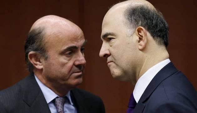 Luis de Guindos y Pierre Moscovici.