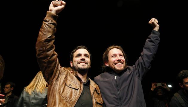 Los líderes de Podemos, Pablo Iglesias y de Izquierda Unida, Alberto Garzón.