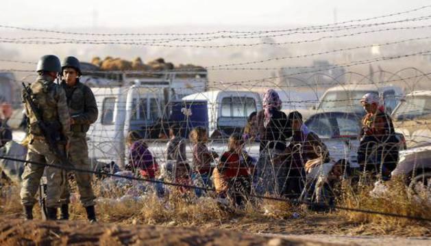 Refugiados sirios en la frontera turca.