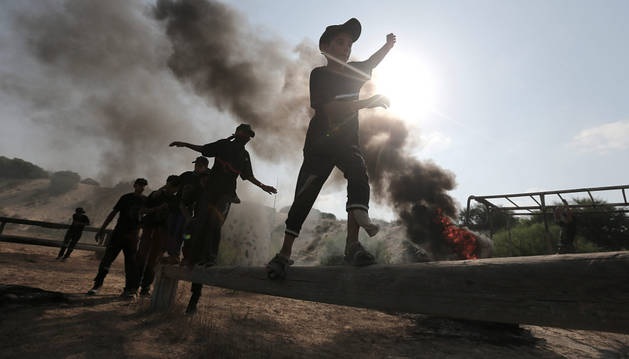 Jóvenes palestinos participan en un campamento de verano de la Yihad Islámica.
