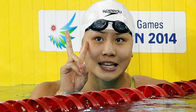La nadadora Chen Xinyi, acusada de dopaje, celebra una victoria en los Juegos Asiáticos de 2014.