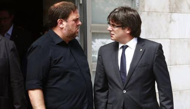 El líder de ERC, Oriol Junqueras, y el presidente de la Generalitat, Carles Puigdemont.