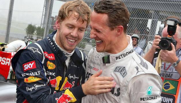 Michael Schumacher junto a Sebastian Vettel durante un Gran Premio en 2012