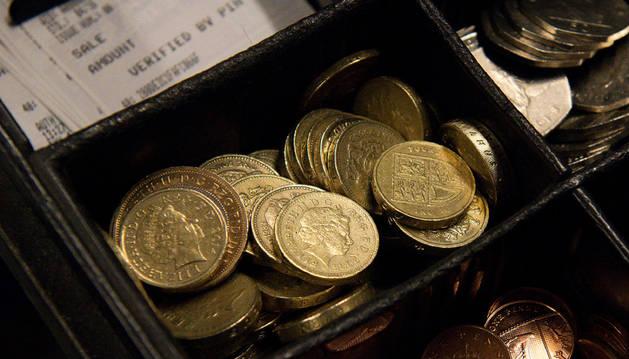Imagen de una caja registradora con libras.