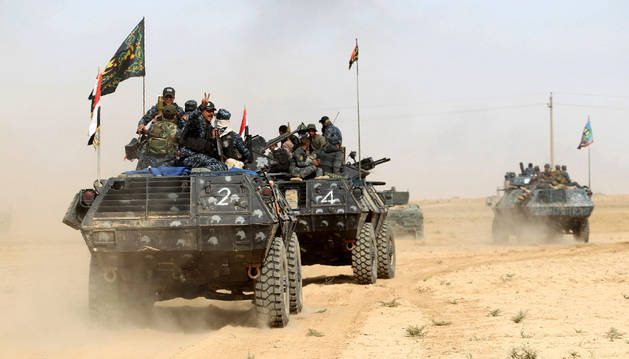 Fuerzas iraquíes desplegadas en Al-Shurah, a 45 kilómetros al sur de Mosul.