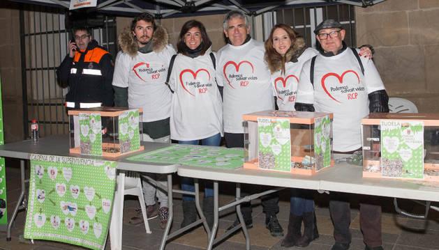 Voluntarios de la iniciativa recaudan fondos en la carrera.