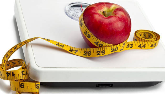 Un peso y una manzana.