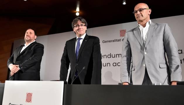 Carles Puigdemont, Oriol Junqueras y Raul Romeva en la ponencia realizada en Madrid
