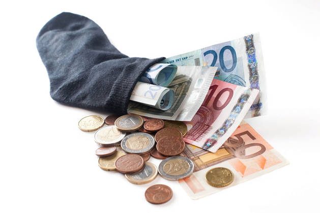 Imagen de varios billetes y monedas.