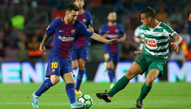 Messi celebra con Piqué un gol del Barcelona