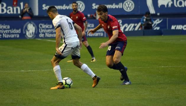 Imágenes del encuentro en El Sadar entre Osasuna y Sporting