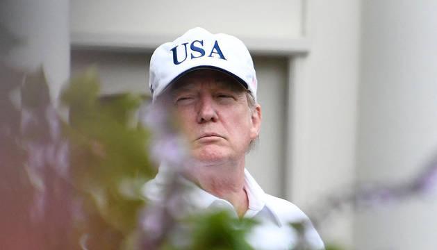 Donald Trump, en la Casa Blanca antes de su partido de golf contra el senador Lindsey Graham.