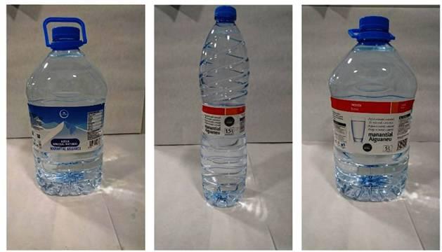 Envases del agua de Eroski retirada.
