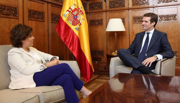 El presidente del Partido Popular Pablo Casado, y la exvicepresidenta del gobierno Soraya Sáez de Santamaría
