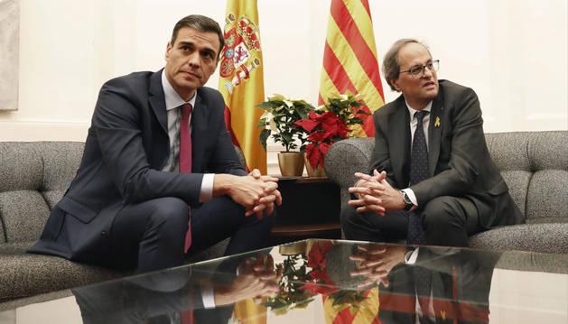 El presidente del Gobierno, Pedro Sánchez, y el de la Generalitat, Quim Torra, durante una reunión que mantuvieron en el Palau de Pedralbes de Barcelona.