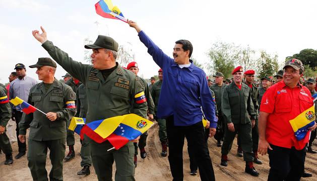 Imagen cedida por la oficina de prensa de Miraflores de Nicolás Maduro participando