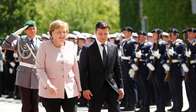 Merkel, en el acto en el que sufrió los temblores.