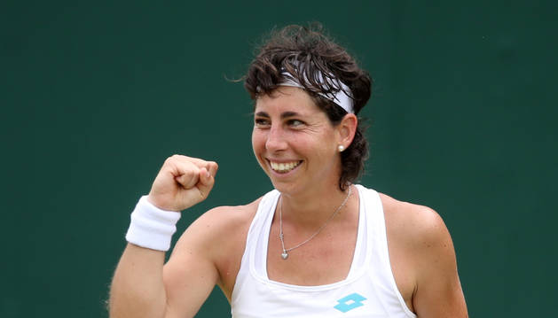 La española Carla Suárez celebra su victoria en Wimbledon.