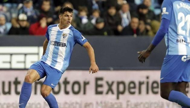Foto del defensor Diego González, en un partido con el Málaga.