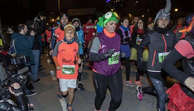 Fotos de la San Silvestre de Pamplona 2019, en la que han participado 5.200 corredores con dorsales.