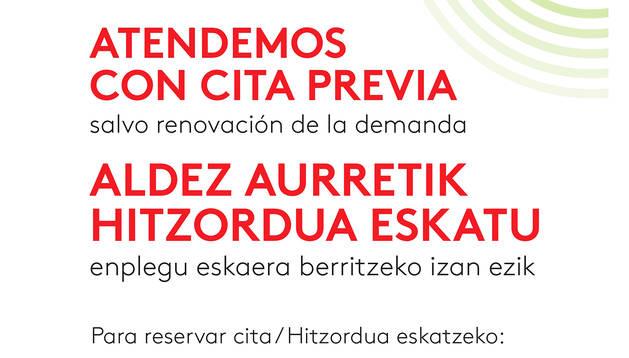 Cartel del servicio de cita del SNE en la oficina de Tudela.