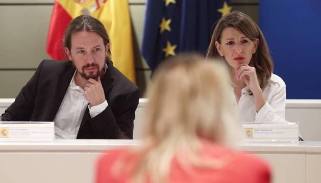 El vicepresidente del Gobierno de Derechos Sociales, Pablo Iglesias, y la ministra de Trabajo, Yolanda Díaz.
