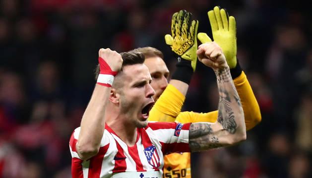 Saúl y Oblak celebran la victoria del Atlético de Madrid.