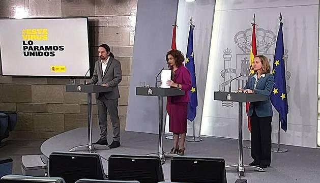 Nadia Calviño, María Jesús Montero y Pablo Iglesias, durante la rueda de prensa.