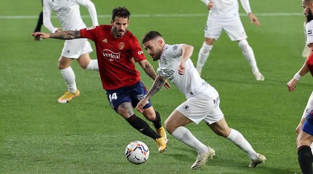 Galería de fotos del partido entre Osasuna y Huesca en El Sadar.