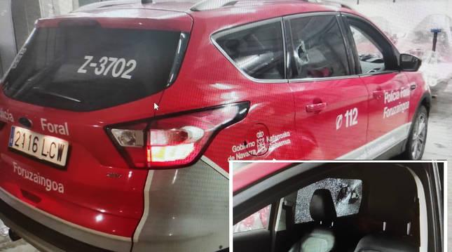 Foto de un coche de la Policía Foral, al que arrojaron una botella que rompió la ventanilla del conductor.