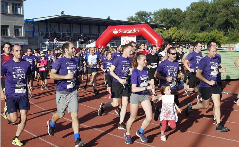 Casi 700 corredores en Burlada, con la Asociación Domena